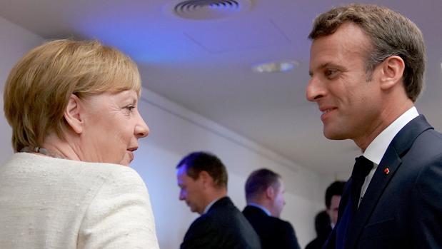Angela Merkel y Emmanuel Macron, canciller alemana y presidente francés, antes de la cumbre del último Consejo Europeo